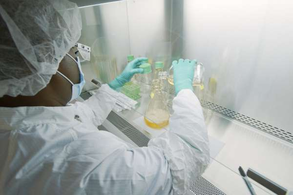 A laboratory worker at Eli Lilly prepares a solution used to manufacture bamlanivimab, a new monoclonal antibody therapy for COVID-19. When given within 10 days of a positive COVID-19 test, these man-made antibodies may help lessen the severity of the disease and reduce the need for hospitalization in people most at risk of developing severe COVID-19.