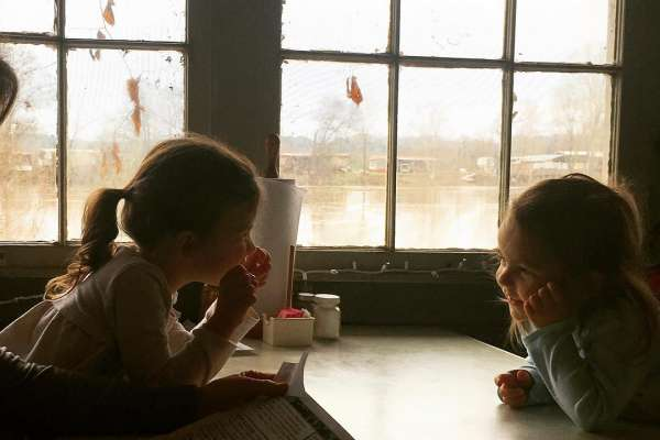 Sisters eating lunch at Ezell's Fish Camp on the Tombigbee River in Lavaca, Alabama