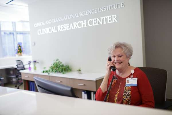 : Marilyn Browning greets visitors at the front desk of the CTSI Clinical Research Center