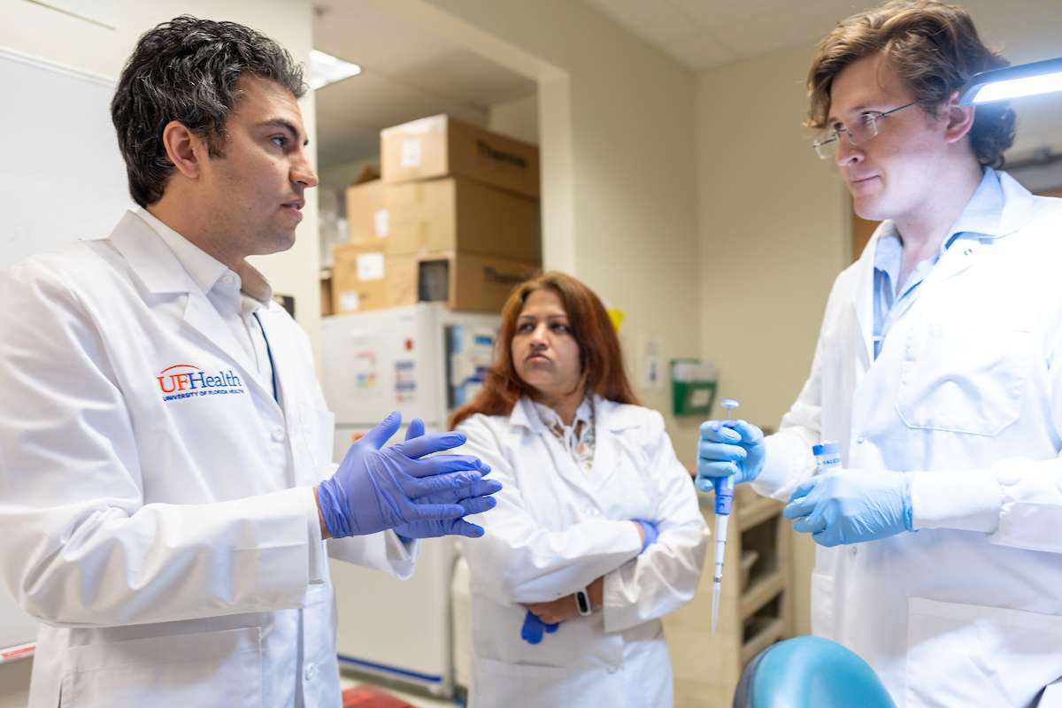 Dr. Elias Sayour consults with other scientists from the McKnight Brain Institute