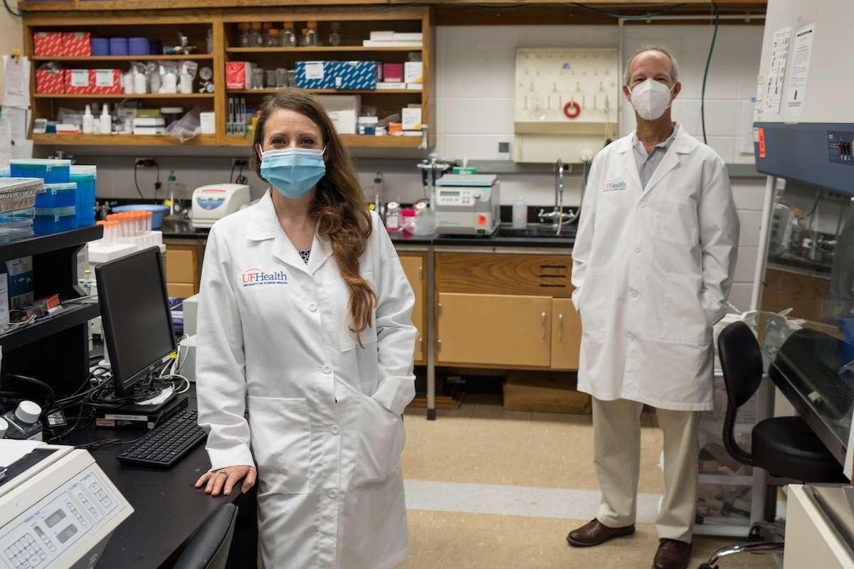 Dr. Leah Reznikov and Dr. David Ostrov are shown in Reznikov's lab on June 5. (Photo by Jesse Jones)