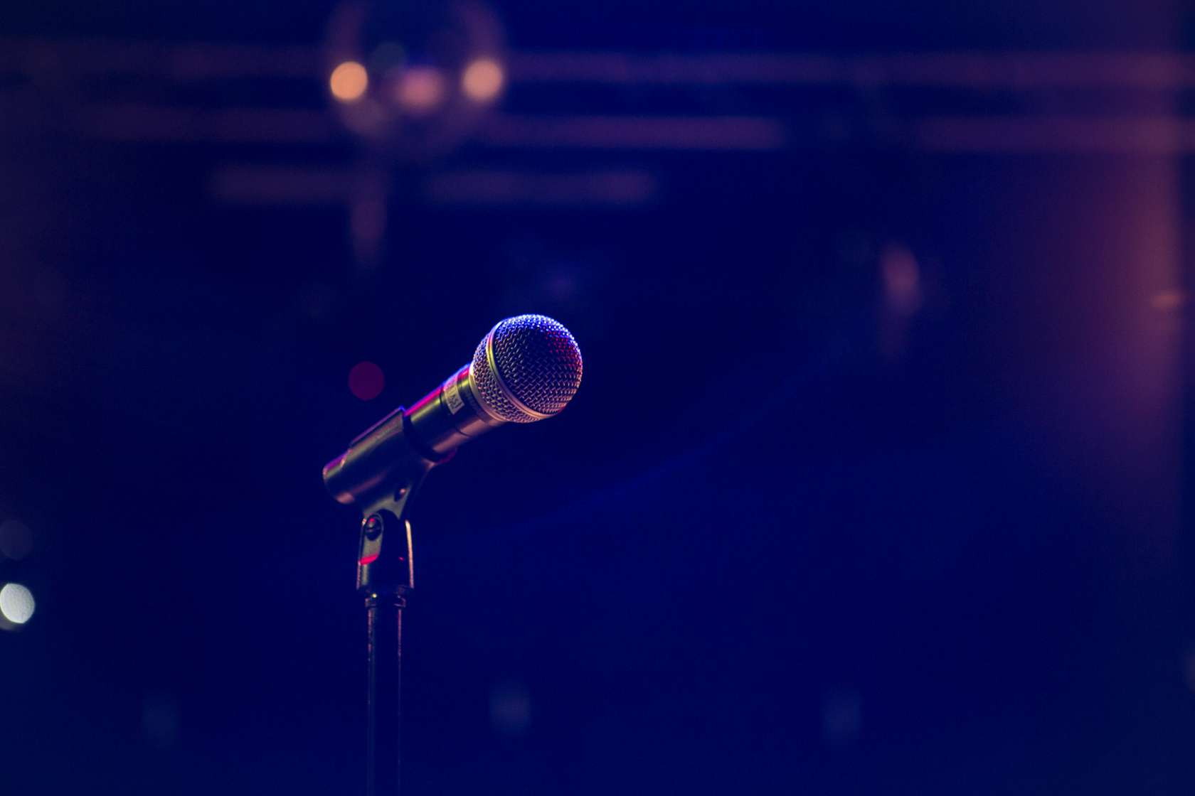 A microphone on a dimly lit stage