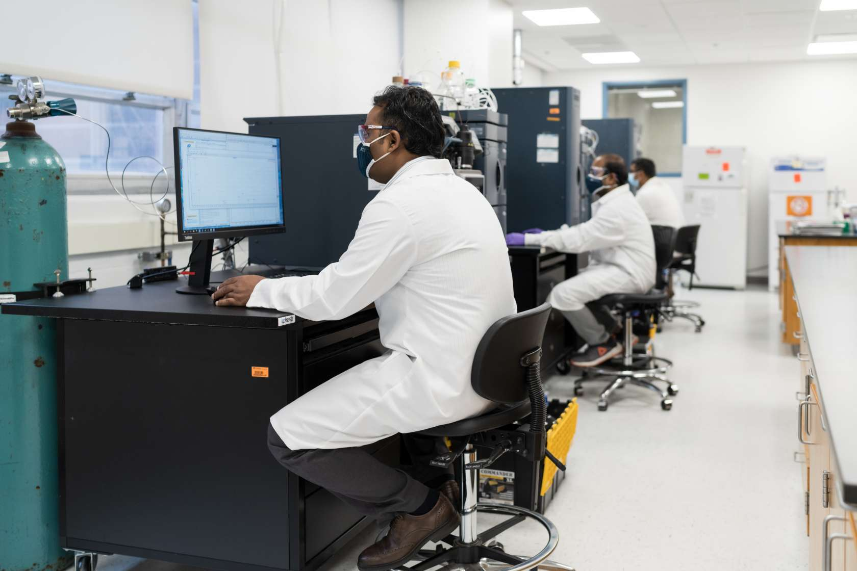 pharmacy lab with staff sitting at computers