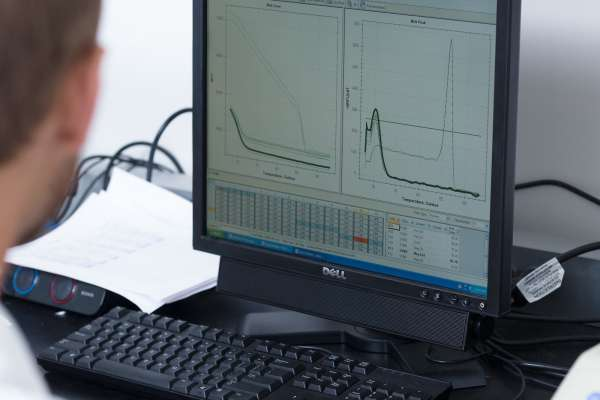 A researcher looks at charts on his computer.